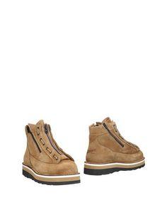 Полусапоги и высокие ботинки Danner