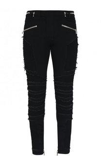 Зауженные джинсы с декоративными потертостями Balmain