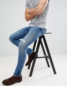 Темно-синие джинсы скинни с рваной отделкой ASOS - Синий