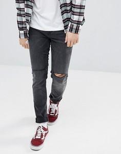 Черные джинсы скинни с рваной отделкой ASOS - Черный
