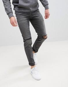 Выбеленные черные джинсы скинни с рваными коленями ASOS - Черный