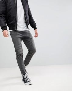 Черные выбеленные суженные книзу джинсы в винтажном стиле ASOS - Черный
