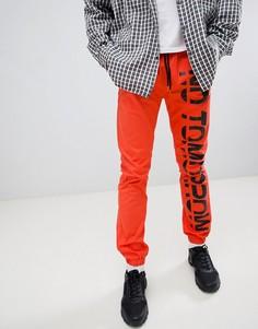 Оранжевые облегающие джоггеры с принтом ASOS - Оранжевый