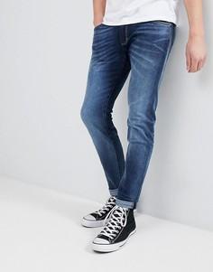 Синие джинсы скинни Wrangler - Синий