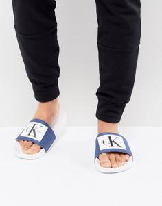 Синие шлепанцы с логотипом Calvin Klein Vital - Синий