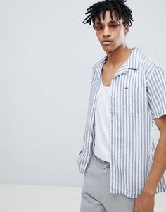 Рубашка классического кроя в сине-белую полоску с короткими рукавами и отложным воротником Tommy Jeans - Темно-синий