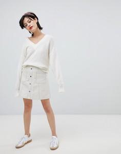 Мини-юбка из искусственной кожи с карманами River Island - Кремовый