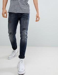 Синие зауженные джинсы Calvin Klein - Синий