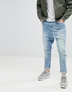 Синие рваные джинсы заниженного кроя ASOS DESIGN - Синий