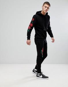 Черный облегающий спортивный костюм с принтом роз ASOS - Черный