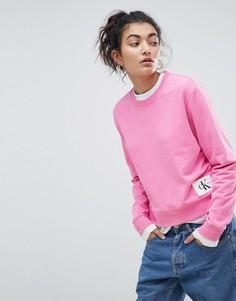 Свитшот с круглым вырезом и нашивкой с логотипом Calvin Klein Jeans - Розовый
