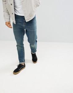 Темные суженные книзу джинсы в стиле винтаж ASOS - Синий