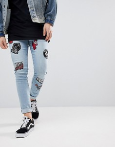 Голубые супероблегающие джинсы с нашивками в байкерском стиле ASOS - Синий