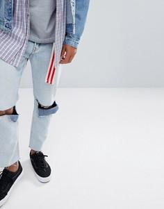Голубые суженные книзу джинсы с рваными коленями Cheap Monday - Синий