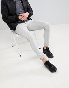 Светло-серые джинсы скинни с эффектом потертости ASOS DESIGN - Серый