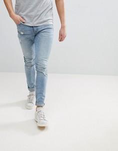 Голубые потертые джинсы скинни ASOS DESIGN - Синий