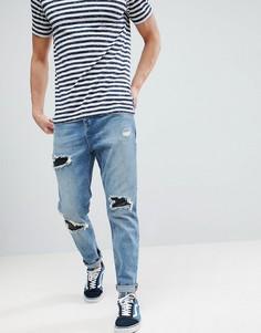 Суженные книзу выбеленные джинсы с рваной отделкой ASOS - Синий
