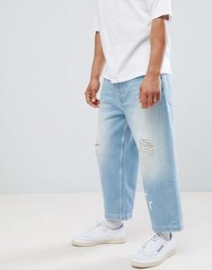 Голубые укороченные джинсы широкого кроя с рваной отделкой ASOS DESIGN - Синий