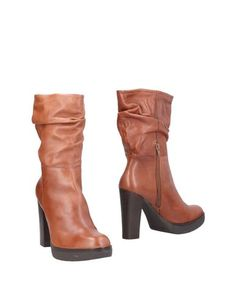 Полусапоги и высокие ботинки EXE