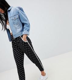 Зауженные брюки с контрастной отделкой и ацтекским принтом ASOS DESIGN Petite - Черный
