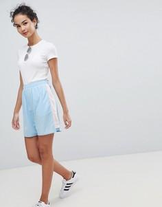 Спортивные шорты в стиле колор блок ASOS DESIGN - Синий