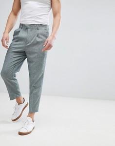 Темно-зеленые зауженные брюки ASOS DESIGN - Зеленый
