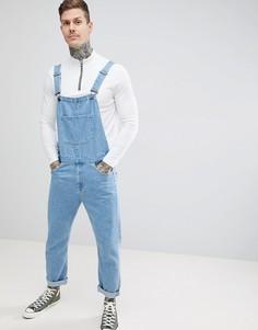Выбеленный джинсовый комбинезон скинни ASOS DESIGN - Синий