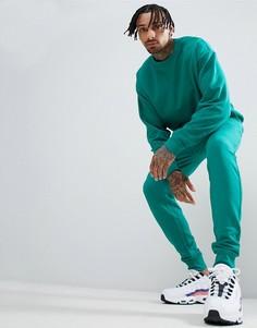 Сине-зеленый спортивный костюм свободного кроя ASOS DESIGN - Зеленый