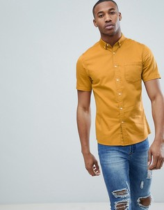 Приталенная эластичная джинсовая рубашка горчичного цвета ASOS DESIGN - Желтый