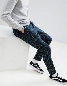 Суженные книзу брюки с принтом тартан ASOS DESIGN - Темно-синий