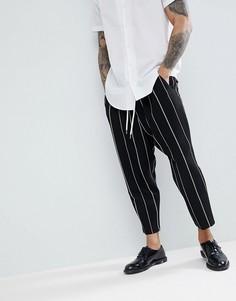 Черные зауженные брюки заниженного кроя с белыми полосками ASOS - Черный