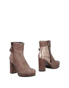 Полусапоги и высокие ботинки Caprice