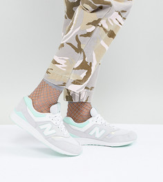 Серые кроссовки со светло-бирюзовыми вставками New Balance 697 - Серый