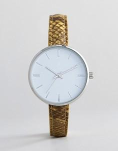 Часы с ремешком из искусственной змеиной кожи ASOS DESIGN - Желтый