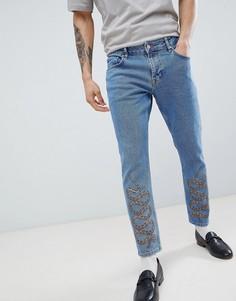 Синие выбеленные джинсы узкого кроя со змеиным принтом ASOS DESIGN - Синий