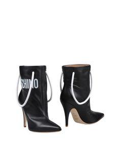 Полусапоги и высокие ботинки Moschino