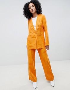 Широкие оранжевые брюки с узором перьев Gestuz - Оранжевый