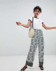 Комбинируемые брюки с широкими штанинами и контрастными принтами Monki - Черный