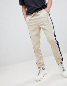 Суженные книзу вельветовые брюки с полосками ASOS DESIGN - Бежевый