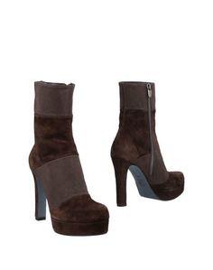 Полусапоги и высокие ботинки Andrea Pinto