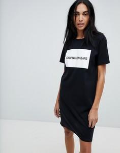 6059b0a5efab5 Трикотажное платье-футболка с логотипом на спине Calvin Klein - Черный