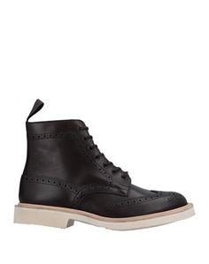 Полусапоги и высокие ботинки Trickers
