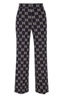 Синие брюки с монограммами Gucci