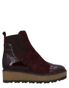 Полусапоги и высокие ботинки Manas