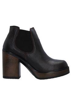 Полусапоги и высокие ботинки NOA A.
