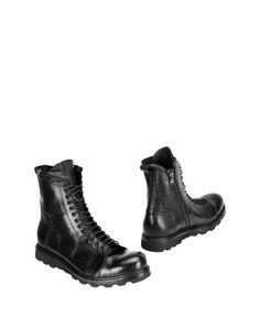 Полусапоги и высокие ботинки Mckanty