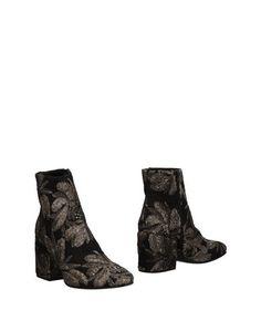Полусапоги и высокие ботинки Nora Barth