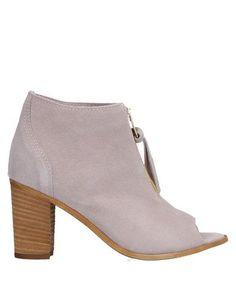 Полусапоги и высокие ботинки Paola Parisi