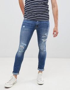 Зауженные джинсы с состаренной отделкой Jack & Jones - Синий