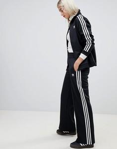 4f44f08eb6c6e Черные спортивные брюки с тремя полосками Adidas Originals - Черный